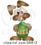 Bunny Holding A Green Easter Egg