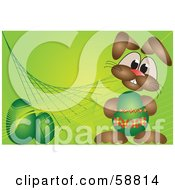 Bunny Holding An Easter Egg On A Green Background