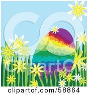 Rainbow Easter Egg Nestled In Flowers And Grass