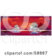Royalty Free RF Clipart Illustration Of Two Dolphins Leaping Over Water Under A Red Ocean Sunset