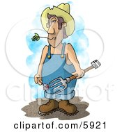 Farmer With A Pitchfork Wearing Coveralls And A Cowboy Hat