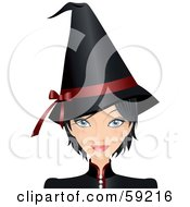 Woman Dressed In A Black Halloween Witch Costume