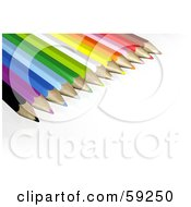 Group Of Colored Pencils In The Upper Left Corner On A White Background