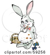 Royalty Free RF Clipart Illustration Of A Chubby Easter Bunny With Chocolate Smears On Its Fur Standing By A Basket And Candy Wrappers by Dennis Holmes Designs