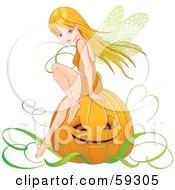 Pretty Autumn Fairy Sitting On A Halloween Pumpkin