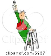 Santas Elf Screwing In A Light Bulb Clipart Picture