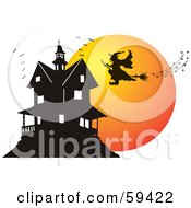 Silhouetted Witch Flying Towards A Haunted House At Dusk