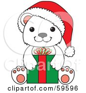 Christmas Polar Bear Cub Wearing A Santa Hat And Sitting With A Present