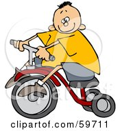Little Boy In A Yellow Shirt Riding A Tricycle