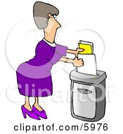Female Secretary Feeding A Paper Shredder Confidential Documents