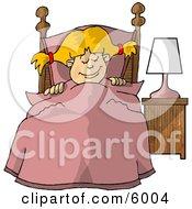 Young Girl Sleeping Peacefully In Her Bedroom