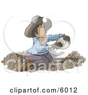 Happy Mexican Gold Miner Finding Gold Nuggets In A Pile Of Dirt Clipart Picture