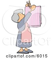 Housewife Hanging Laundry Out To Dry On A Clothesline Clipart Picture