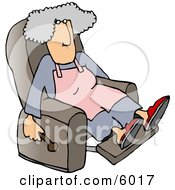 Housewife Relaxing On A Comfortable Recliner Chair