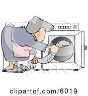 Housewife Putting Wet Clothes Into A Dryer Clipart Picture