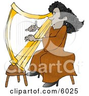 Female African American Harpist Playing The Harp