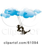 Silhouetted Boy And Girl Swinging From Blue Clouds
