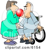 Female Nurse Giving A Male Senior Patient In A Wheelchair A Test With A Respiratory Therapy Balloon