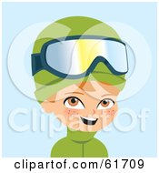 Little Red Haired Caucasian Boy Wearing Green Winter Clothes And Skiing Goggles