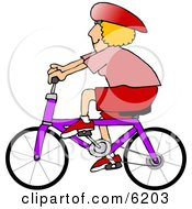 Woman Wearing A Helmet And Riding A Bicycle Clipart Picture