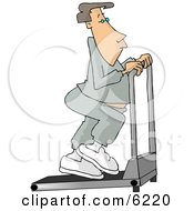 Man In Sweats Exercising On A Treadmill In A Gym Clipart Picture