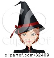 Beautiful Young Witch In A Black Hat With A Red Ribbon