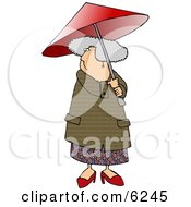 Gray Haired Senior Woman Walking With An Umbrella On A Rainy Day