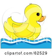 Royalty Free RF Clipart Illustration Of A Cute Swimming Yellow Ducky In Profile