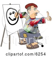 Male Painter Artist Giving The Thumbs Up While Painting A Smiley Face On Canvas