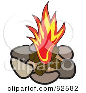Red Flame Over Logs In A Stone Fire Pit