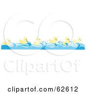 Group Of Six Swimming Yellow Ducks In A Row