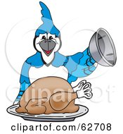 Royalty Free RF Clipart Illustration Of A Blue Jay Character School Mascot Serving A Thanksgiving Turkey by Toons4Biz