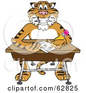 Royalty Free RF Clipart Illustration Of A Tiger Character School Mascot Doing Homework At A Desk by Toons4Biz