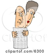 Man And Woman Reading The Local Newspaper Together
