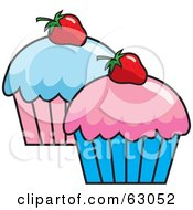 Two Cupcakes Topped With Pink And Blue Frosting And Strawberries