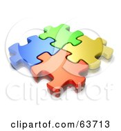 Interlocked Blue Green Orange And Yellow Jigsaw Puzzle Pieces