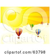 Colorful Hot Air Balloons Above The Clouds In A Yellow Sunny Sky