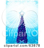 Tall Blue Christmas Tree Made Of Baubles With A Shining Star