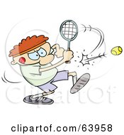 Focused Man Swinging A Racket To Hit A Tennis Ball