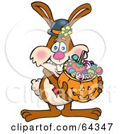 Trick Or Treating Bunny Holding A Pumpkin Basket Full Of Halloween Candy