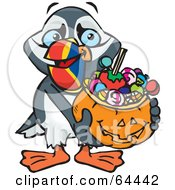 Royalty Free RF Clipart Illustration Of A Trick Or Treating Puffin Holding A Pumpkin Basket Full Of Halloween Candy by Dennis Holmes Designs
