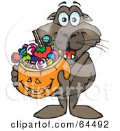 Royalty Free RF Clipart Illustration Of A Trick Or Treating Sea Lion Holding A Pumpkin Basket Full Of Halloween Candy