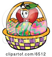 Red Apple Character Mascot In An Easter Basket Full Of Decorated Easter Eggs Clipart Picture