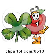 Red Apple Character Mascot With A Green Four Leaf Clover On St Paddys Or St Patricks Day Clipart Picture