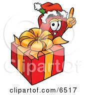 Red Apple Character Mascot With A Christmas Present Clipart Picture