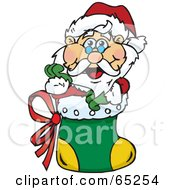 Royalty Free RF Clipart Illustration Of A Jolly Santa Nestled In A Christmas Stocking