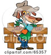 Cowboy Wiener Dog By A Wooden Fence