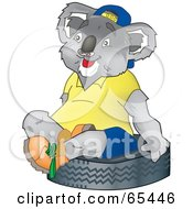 Royalty Free RF Clipart Illustration Of A Koala Sitting On A Tire