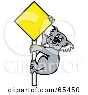 Koala Climbing A Blank Yellow Sign