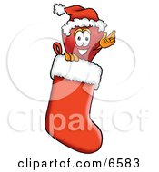 Red Apple Character Mascot Wearing A Santa Hat Inside A Red Christmas Stocking